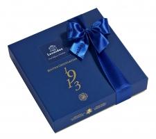 """Луксузно плаво пакување """"Heritage 1913"""" со 16 пралини"""